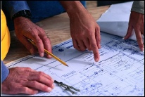 Contractor reviewing home plans